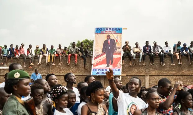 People holding the poster of Faustin-Archange Touadera, the president of the Central African Republic, at a campaign rally in Bangui, 12 December. Photograph: Xinhua/REX/Shutterstock